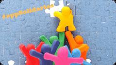 Muñecos construyen un puzzle para ilustrar este post que habla de cooperación y solidaridad